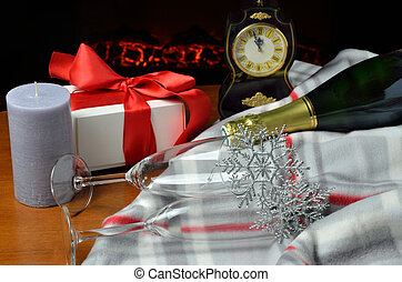 Five minutes to midnight - Two glasses, bottle of champagne ...
