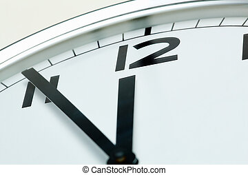 Five minutes to twelve - Photo of clock showing five minutes...