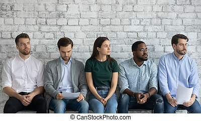 Five multiracial unemployed applicants feels nervous about ...