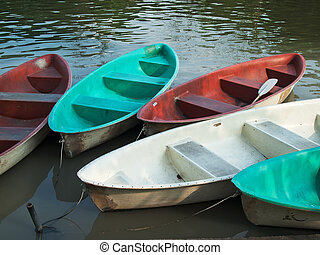 Five Paddle boats made of fiberglass in the water park