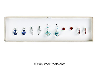 five pairs of earrings with stones