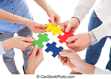 Five People Hand With Puzzle - Close-up Of Five People Hand...