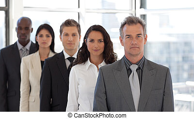 Five Person Business team standing being Serious