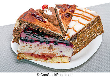 Five pieces of cake on a white plate