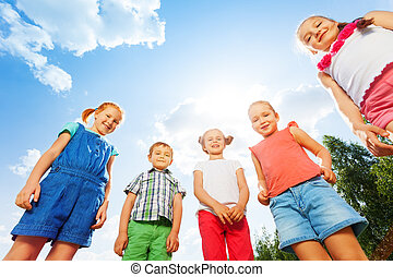 Five pretty children looking down at the camera