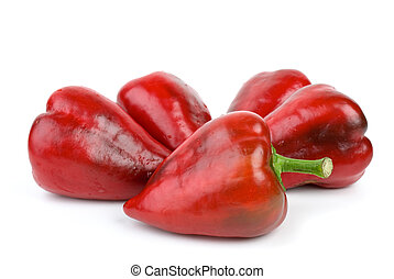 Five red sweet peppers