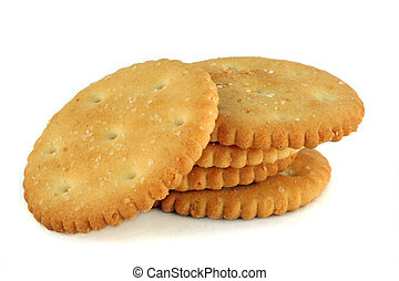 five salty crackers stacked over white