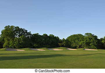 Five Sand Traps on a Golf Course with Copy Space
