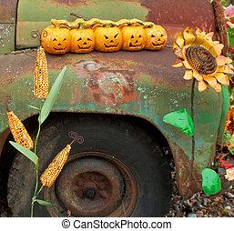 Five Small Pumpkins on Antique Car