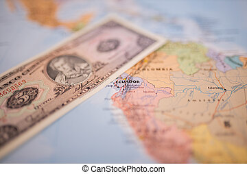 Five sucres bill next to Ecuador on a colorful and blurry map of South America
