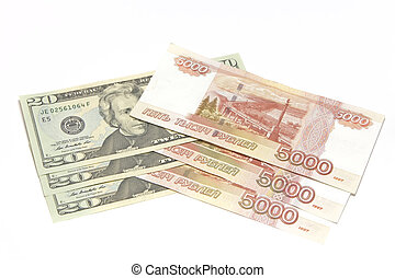 Five thousand dollar bills and twenty US dollars on a white background, currency exchange rubles and dollars