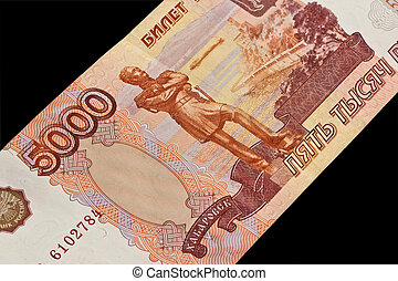 Five thousand rubles on a black background