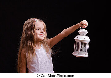 Five-year girl shines candlestick