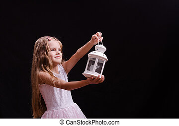 Five-year girl shines candlestick into the distance