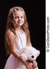 Five-year girl with a teddy bear