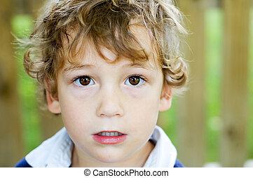 boy with big brown eyes