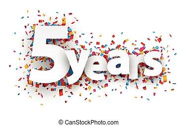 Five years paper confetti sign.