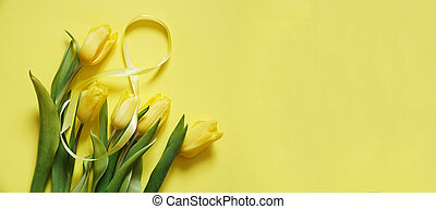 Five yellow tulips on a yellow background with the number eight made of ribbon
