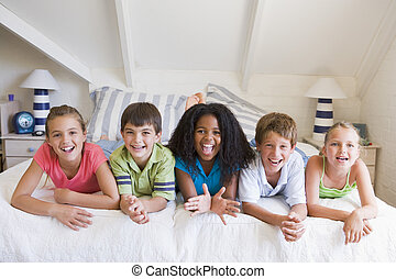 Five Young Friends Lying Down Next To Each Other