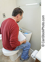 Fix bathoom water leaks - Plumber replacing toilet flapper ...
