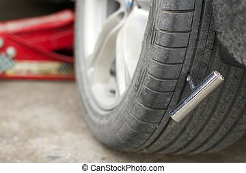 Nail in car tire