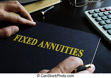 Fixed Annuities. Book on an office table.
