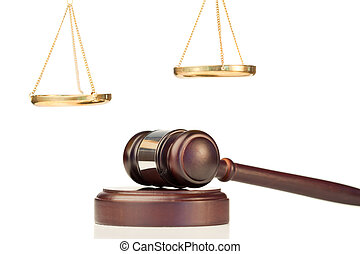 Fixed gavel and golden scale of justice on a white...