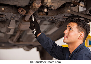 Fixing a car at an auto shop