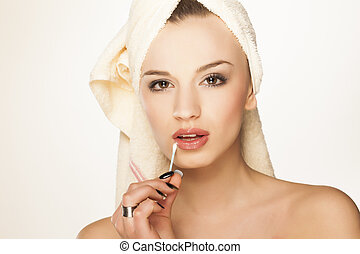 fixing a makeup with a cotton swab - beautiful attractive ...