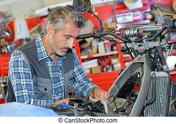 fixing a motorcycle