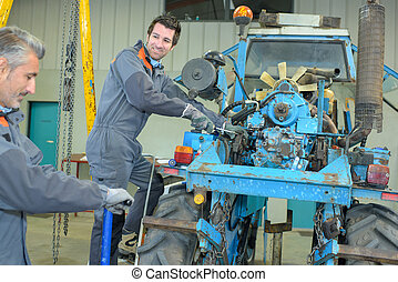 fixing a tractor