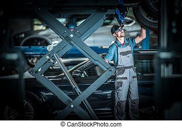 Fixing Broken Car on a Lift