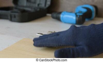 Fixing door furniture hinges. Repair of a bedside table of...