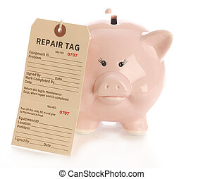 fixing financial problems - repair tag hanging on pink piggy...