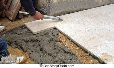 Fixing floor with cement - A construction worker fixing...