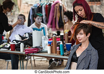Fixing Performers' Hairdo - Makeup artist with red hair...