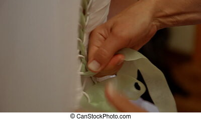 Fixing the wedding dress - Mom helps her daughter to fix the...
