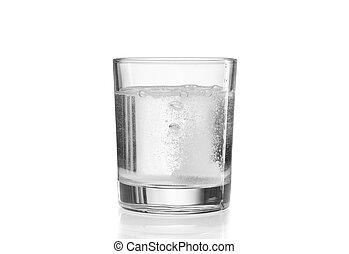 Fizzy tablet in glass of water.