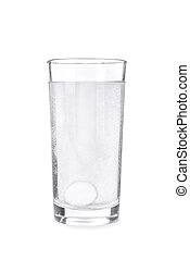 Fizzy tablet in glass of water isolated on white