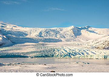 Fjallsarlon Iceberg lagoon with Vatnajokull glacier in Iceland