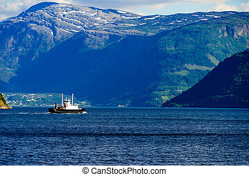 Fjord landscape with ferry, Norway