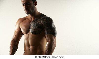 fléchir, culturiste, sans chemise, musculaire, studio