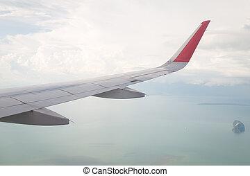 flügel , von, ein, motorflugzeug, fliegendes, oben, der, wasserlandschaft, und, viele, insel