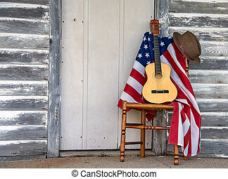 flag and guitar with hat on chair