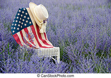 flag and hat on chair in field