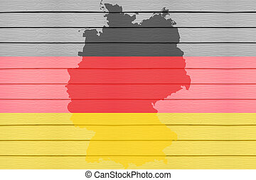 Flag and map of Germany on wood background.