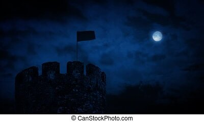 Castle turret with flag blowing in the wind on stormy night