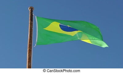 Flag Brazil - Brazil flag in slow motion on blue sky