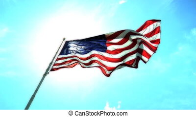 High definition clip of the American flag wavering in the wind against a beautiful blue sky.
