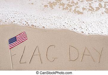 Flag day background on the sandy beach near ocean